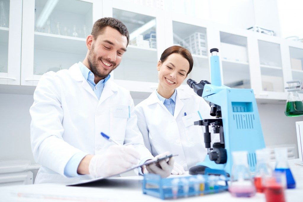 scientists in the lab doing research