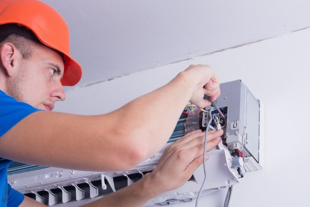 Electrician repairing air conditioner