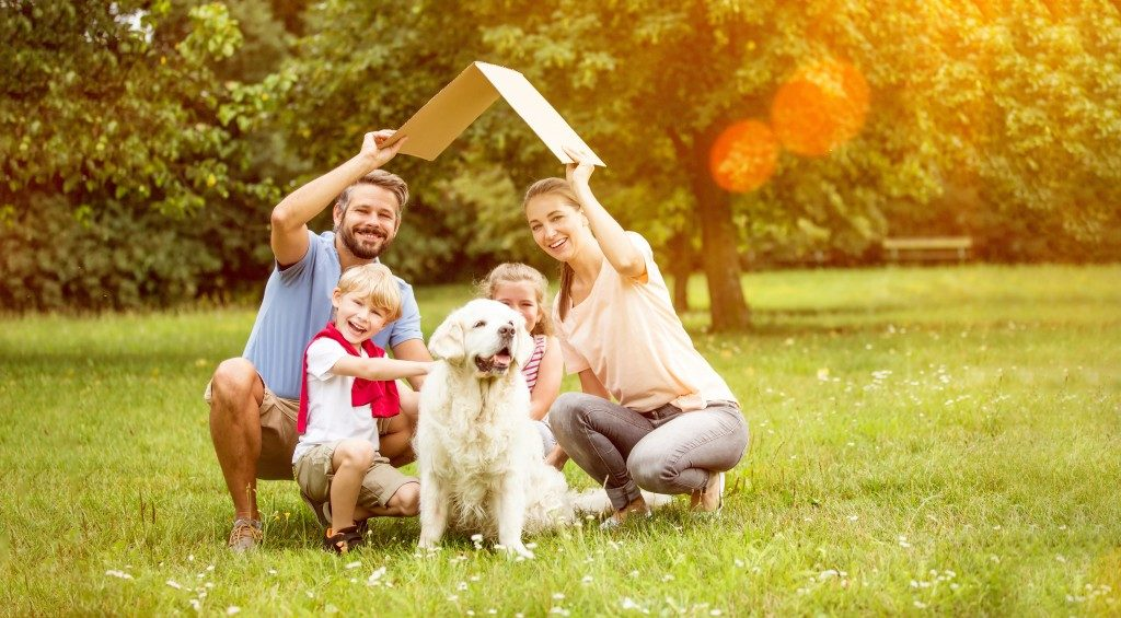 Happy family in their backyard with dog