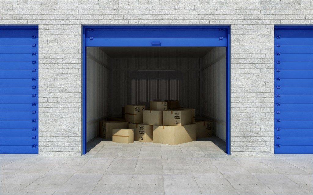 half open garage door with boxes inside