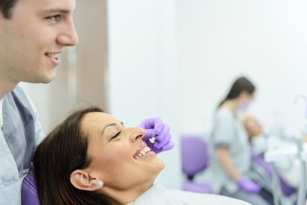 woman getting a dental implant