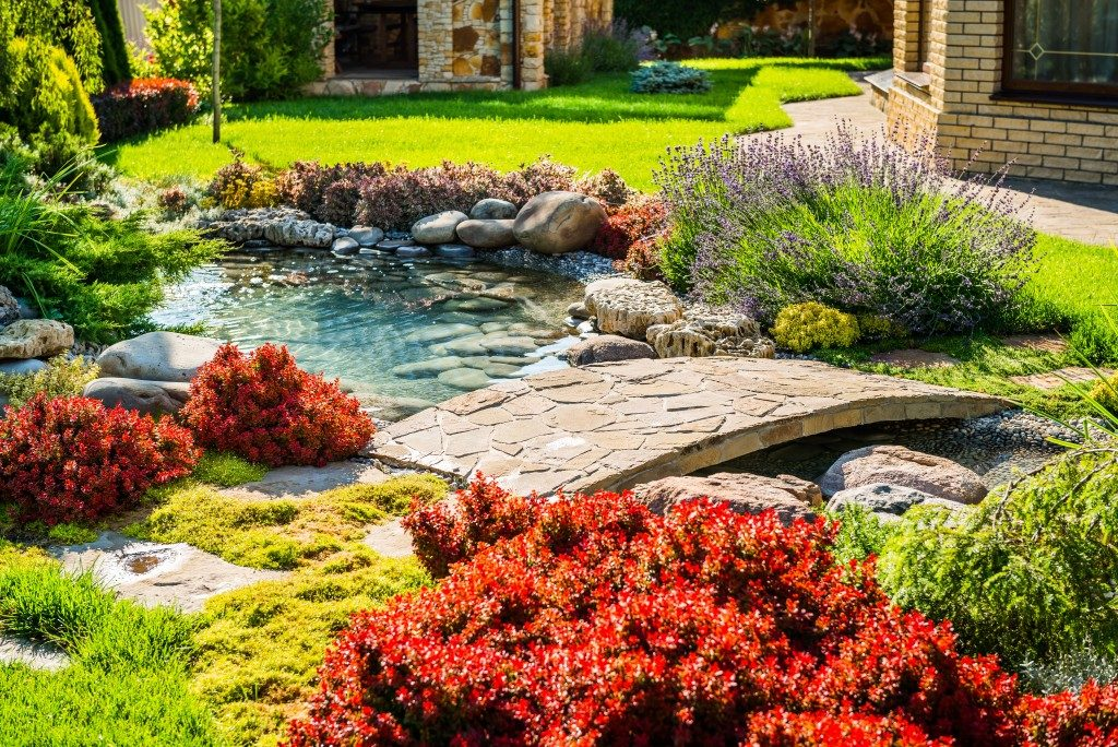 backyard garden landscaping with pond and small bridge