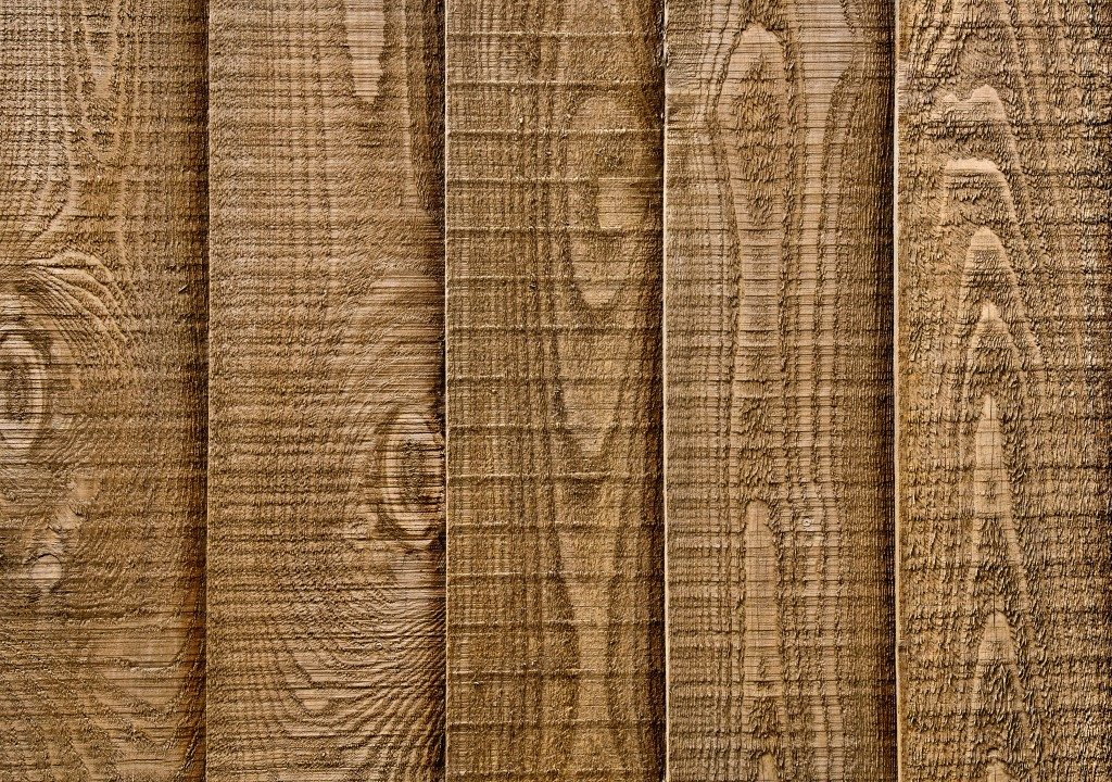 A close up section of wooden garden fencing with vertical