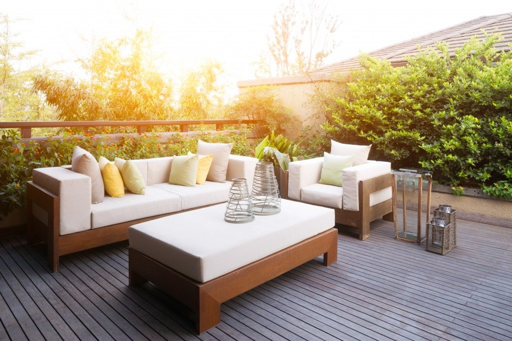 wooden outdoor deck with couch