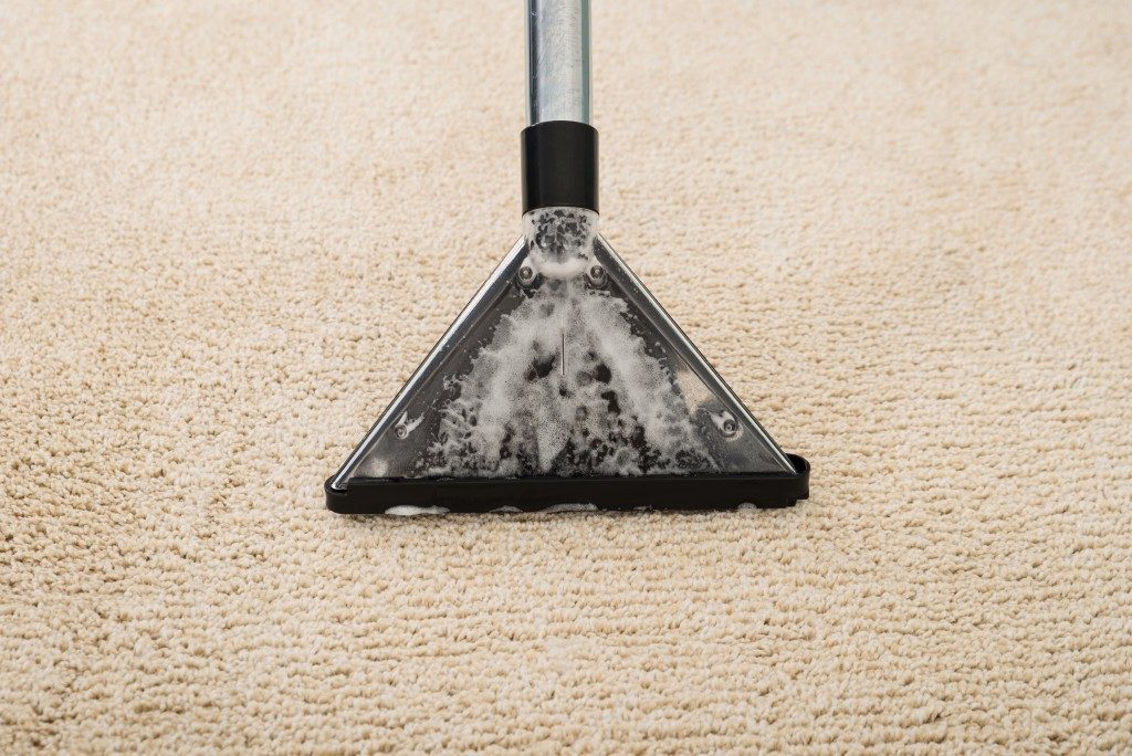 electric vacuum cleaner over the carpet