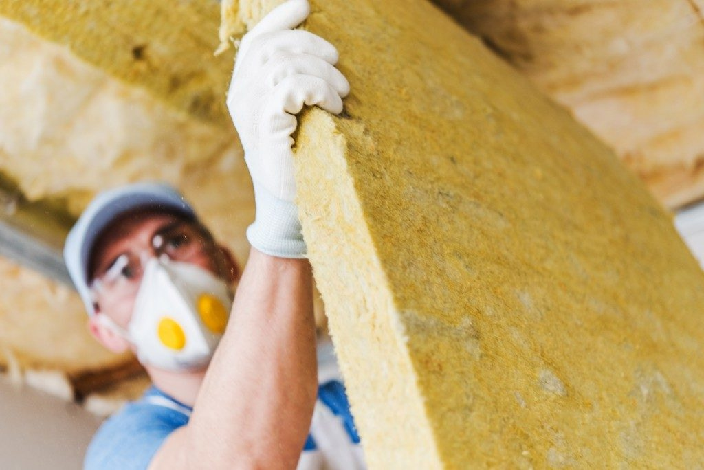 man installing a cotton insulator