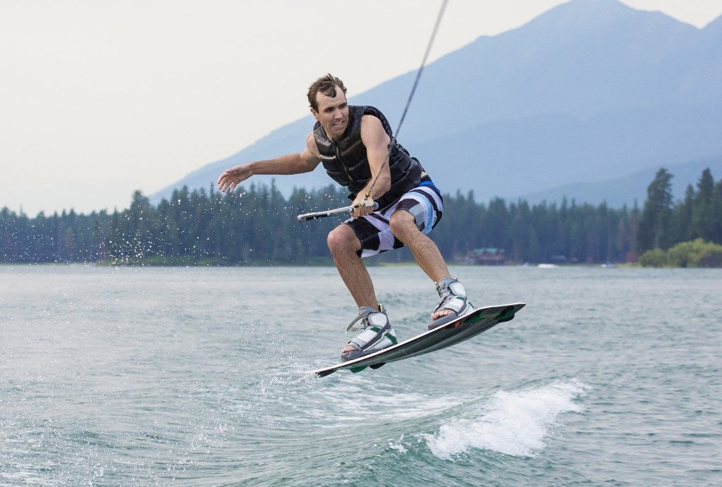 Man wakeboarding on a beautiful mountain lake
