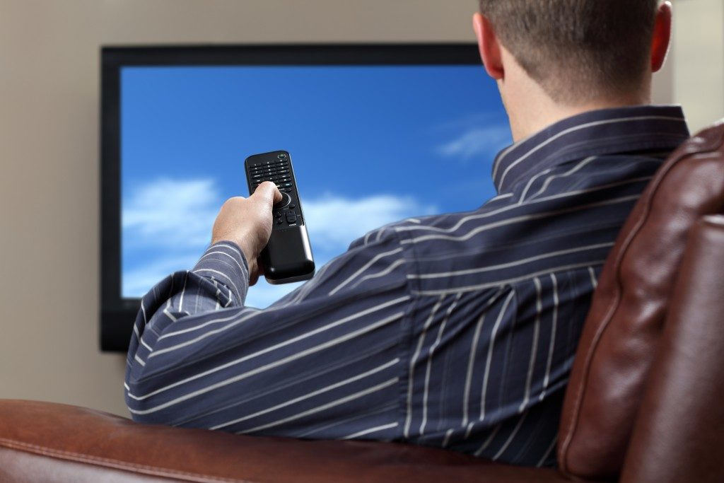 man watching tv on the sofa