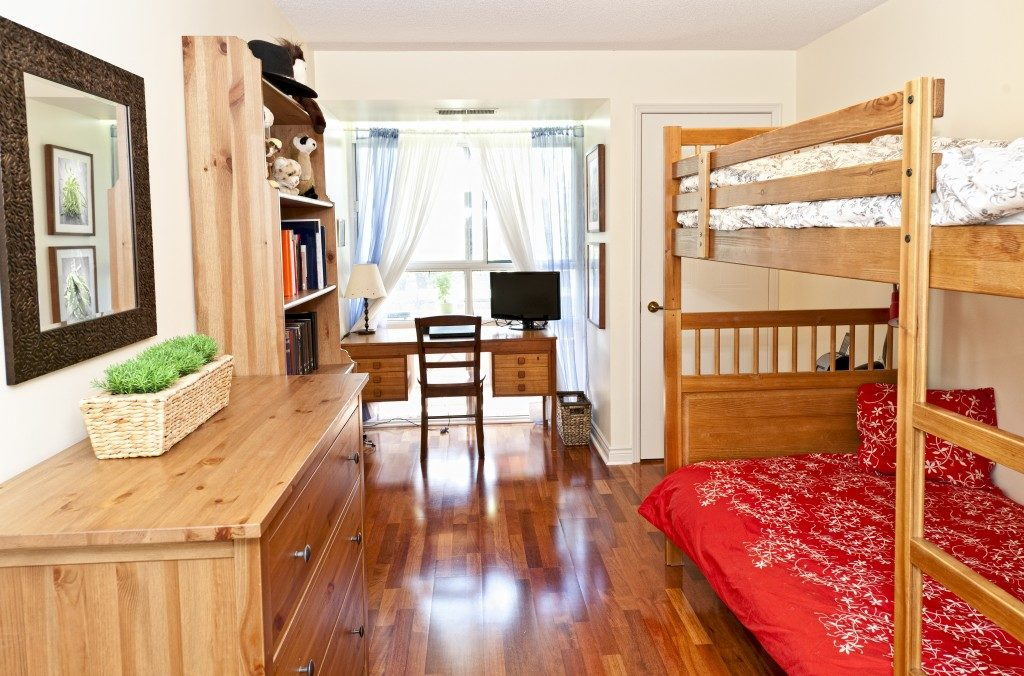 Student bedroom with hardwood floor and bunk beds
