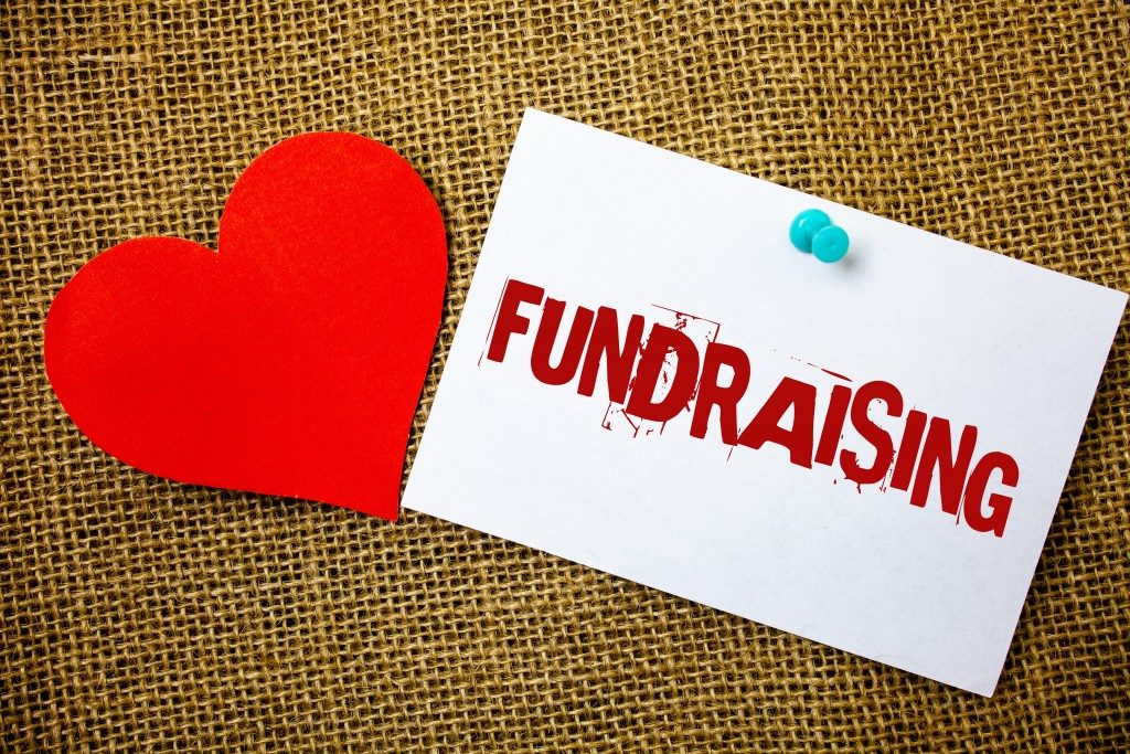 hand writing showing Fundraising