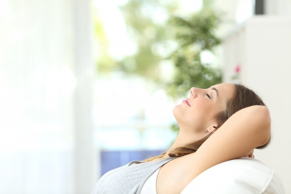 Profile of a beautiful woman relaxing lying on a couch