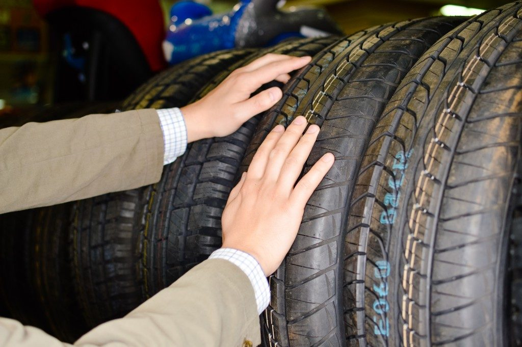 man choosing tires