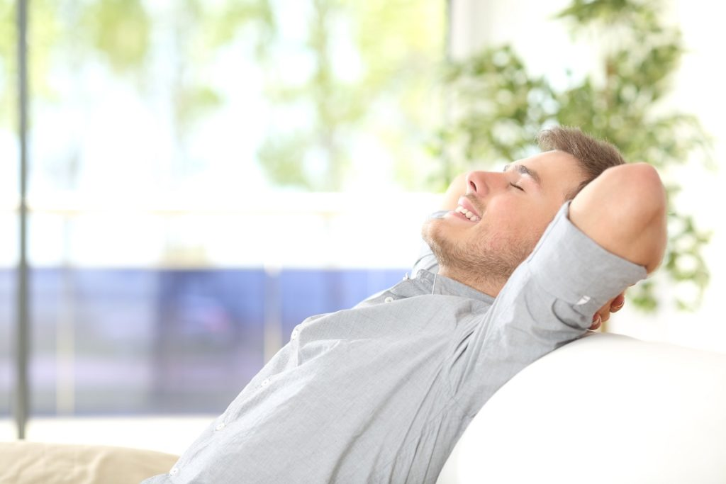 man taking rest on the couch