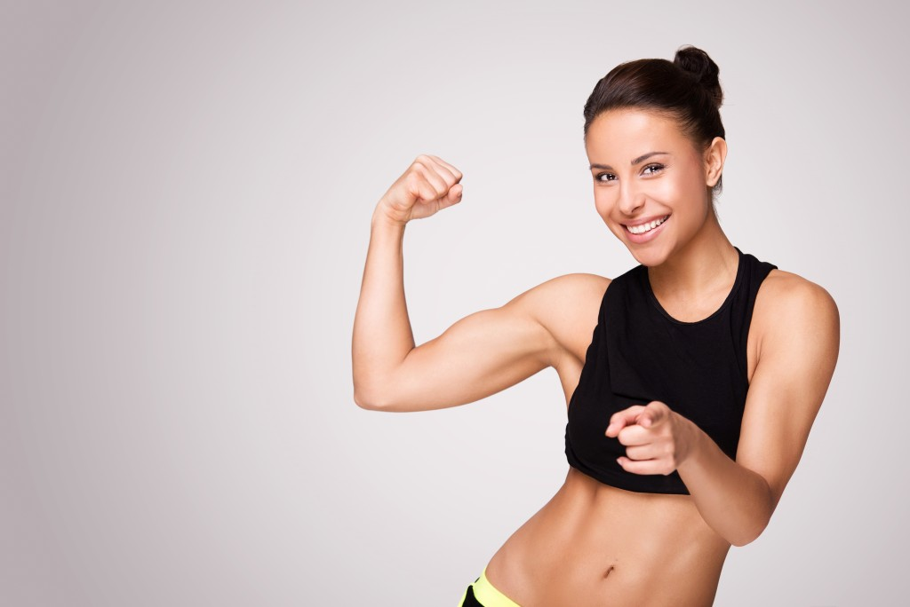 woman flexing her muscle