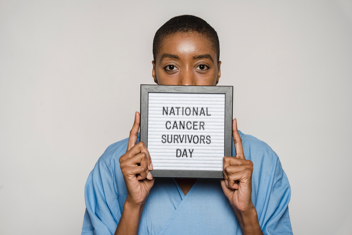 woman holding up national cancer survivors day