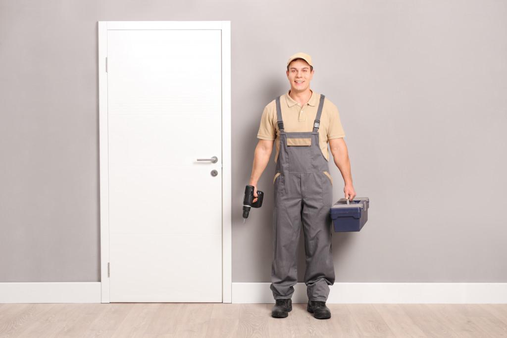 man holding toolbox
