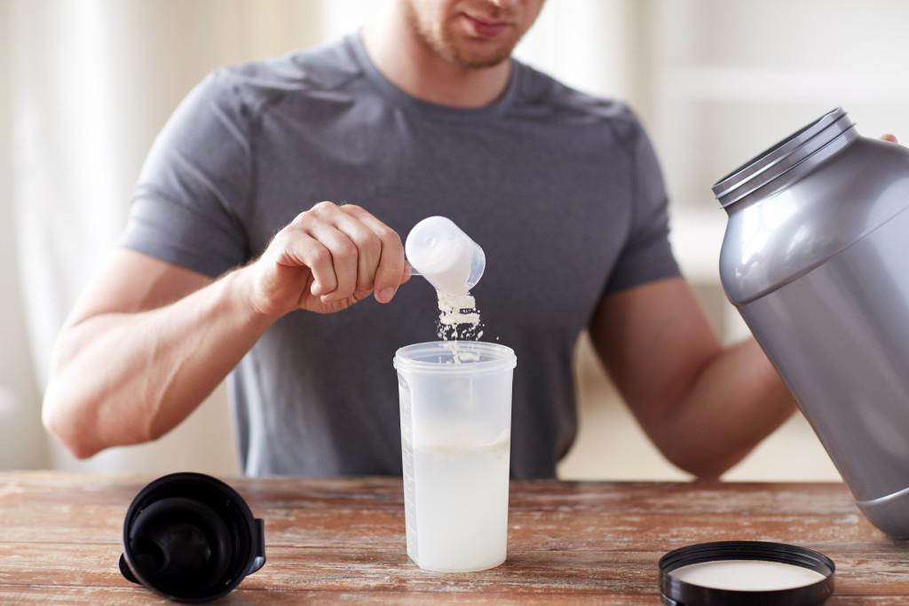 man preparing whey protein